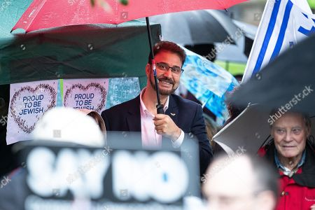 Labour MP Afzal Khan at the back of the crowd.