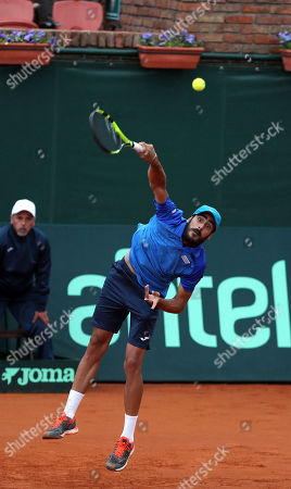 Uruguayan tennis player Rodrigo Arus, playing with Nicolas Xiviller (out of frame) serves a ball to Mexican Miguel Reyes and Santiago Gonzalez, during their Davis Cup doubles game, in Montevideo, Uruguay, 16 September 2018.