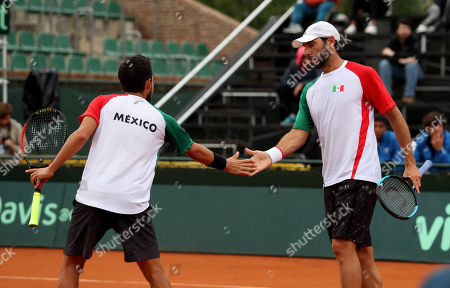 Mexican tennis players Miguel Reyes (L) and Santiago Gonzalez (R) in action before Uruguayan Nicolas Xiviller and Rodrigo Arus during their Davis Cup doubles game, in Montevideo, Uruguay, 16 September 2018.