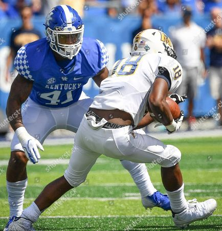 Kentucky Wildcats linebacker Josh Allen (41) prepares to tackle Murray State Racers wide receiver Rodney Castille (18) during the second half an NCAA college football game in Lexington, Ky