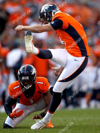 Denver Broncos kicker Brandon McManus (8) kicks the game winning field goal as punter Marquette King