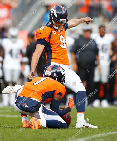 Denver Broncos kicker Brandon McManus (8) kicks the game winning field goal as punter Marquette King (1) holds during the second half of an NFL football game against the Oakland Raiders, in Denver. The Broncos won 20-19