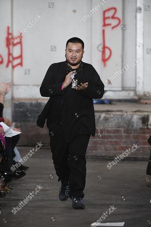 A Sai Ta on the catwalk