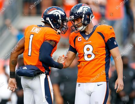Denver Broncos kicker Brandon McManus (8) celebrates his game winning field goal with punter Marquette King (1) during the second half of an NFL football game against the Oakland Raiders, in Denver. The Broncos won 20-19
