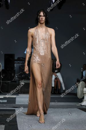 Stock Image of Ashish Gupta. A model wears a creation by designer Ashish during his Spring/Summer 2019 runway show at London Fashion Week in London