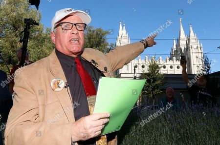 Sam Young speaks during a press conference, in Salt Lake City. Young, a Mormon man who led a campaign criticizing the church's practice of allowing closed-door, one-on-one interviews of youth by lay leaders has been kicked out of the faith. Young read a verdict letter for the first time Sunday that had been delivered to him following an earlier disciplinary hearing with local church leaders in Houston. Young, a 65-year-old lifelong Mormon, becomes the third high-profile member of the faith who led protests about church policy to be excommunicated in recent years