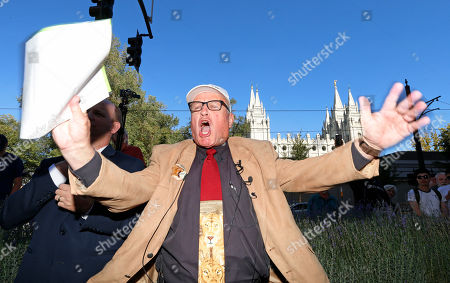 Sam Young reacts after reading a letter detailing his excommunication proceedings from the Mormon Church during a news conference, near Temple Square, in Salt Lake City. Young, a Mormon man who led a campaign criticizing the church's practice of allowing closed-door, one-on-one interviews of youth by lay leaders has been kicked out of the faith. Young, a 65-year-old lifelong Mormon, becomes the third high-profile member of the faith who led protests about church policy to be excommunicated in recent years
