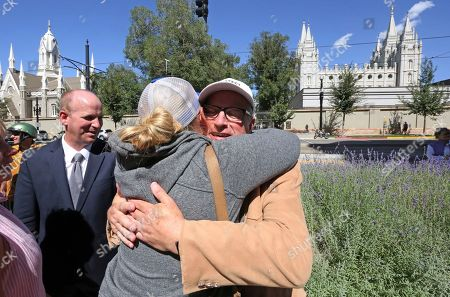 Supporter Melissa Georgi hugs Sam Young following a press conference, in Salt Lake City. Young, a Mormon man who led a campaign criticizing the church's practice of allowing closed-door, one-on-one interviews of youth by lay leaders was kicked out of the faith. Young read a verdict letter for the first time Sunday that had been delivered to him following an earlier disciplinary hearing with local church leaders in Houston