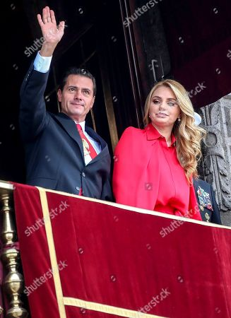 President Enrique Pena Nieto waves to the crowd next to first lady Angelica Rivera during the Independence Day military parade in the Zocalo of Mexico City, . Mexico is celebrating its independence from Spain