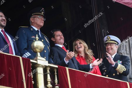 Stock Picture of Mexican President Enrique Pena Nieto, center left, and first lady Angelica Rivera, share a laugh with Admiral Vidal Soberon, right, during the Independence Day military parade in the Zocalo of Mexico City, . Mexico is celebrating its independence from Spain