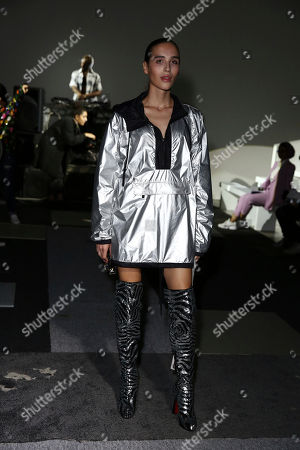 Maxim Magnus poses for photographers on arrival at the Ashish, Spring/Summer 2019 runway show at London Fashion Week in London