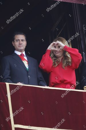 Mexican President Enrique Pena Nieto (L) and his wife Angelica Rivera (R) observe the parade celebrating Mexico?s Independence day, in Mexico City, Mexico, 16 September 2018.