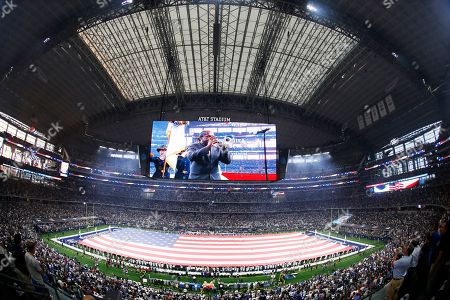 National Anthem performer Freddie Jones is shown on the video screen before an NFL football game between the Dallas Cowboys and the New York Giants in Arlington, Texas