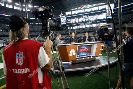L to R) NBC broadcasters Liam McHugh, Cris Collinsworth and Al Michaels before an NFL football game between the Dallas Cowboys and the New York Giants in Arlington, Texas