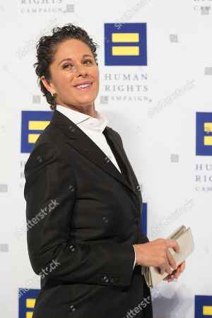 Comedian Dana Goldberg poses for photographers upon arriving at the Human Rights Campaign National Dinner in Washington