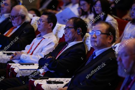 Stock Photo of Japanese laureate of Nobel Prize in Physics 2014 Shuji Nakamura (C) and other guests attend science communication forum during World Conference on Science Literacy at the Beijing International Convention Center, in Beijing, China, 17 September 2018. The conference theme of 'Science Literacy for a Shared and Better Future', is the first international conference dedicated to promoting public science literacy. The conference will be held from 17 to 19 September 2018, and will comprise more than 40 activities, including sessions, exhibitions and special events.