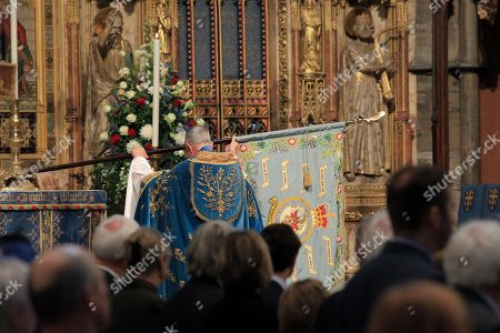 The Standard of the 92 Squadron of the Royal Air Force is handed to The Dean of Westminster, The Very Reverend Dr John Hall,  to be placed on the High Altar during the service.
