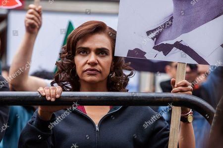 Stock Photo of Aida Lopez as Chela Lagos
