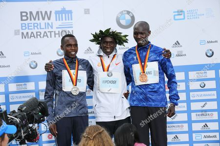 Stock Picture of Kenyan Eliud Kipchoge sets a new world record at the marathon in Berlin. He is the first runner to undercut the mark of two hours and two minutes.Kipchoge is the first to complete the classic 42.195 kilometers under 2:02 hours. Second was Kipchoges compatriot Amos Kipruto (2:06:23 hours) ahead of former world record holder Wilson Kipsang (Kenya / 2: 06: 48).