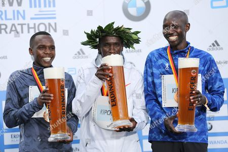 Stock Photo of Kenyan Eliud Kipchoge sets a new world record at the marathon in Berlin. He is the first runner to undercut the mark of two hours and two minutes.Kipchoge is the first to complete the classic 42.195 kilometers under 2:02 hours. Second was Kipchoges compatriot Amos Kipruto (2:06:23 hours) ahead of former world record holder Wilson Kipsang (Kenya / 2: 06: 48).