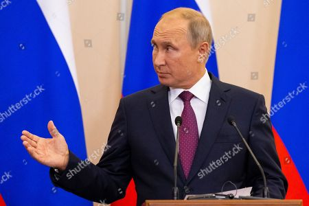 Russian President Vladimir Putin gestures  during the joint news conference with Turkish President Recep Tayyip Erdogan following the talks in the Bocharov Ruchei residence in the Black Sea resort of Sochii, Russia, Monday, 17 September 2018.   The presidents of Russia and Turkey are meeting in the Russian Black Sea resort of Sochi in a bid to find a diplomatic resolution to the crisis around Idlib, a rebel-held region in Syria.