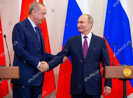 Russian President Vladimir Putin (R)  and Turkish President Recep Tayyip Erdogan (L) shake hands after their joint news conference following the talks in the Bocharov Ruchei residence in the Black Sea resort of Sochi, Russia, Monday, 17 September 2018. The presidents of Russia and Turkey are meeting in the Russian Black Sea resort of Sochi in a bid to find a diplomatic resolution to the crisis around Idlib, a rebel-held region in Syria.