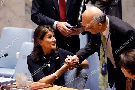 Nikki Haley, Koro Bessho. U.S. Ambassador Nikki Haley, left, greets Japan's Ambassador Koro Bessho in the United Nations Security Council, at U.N. headquarters