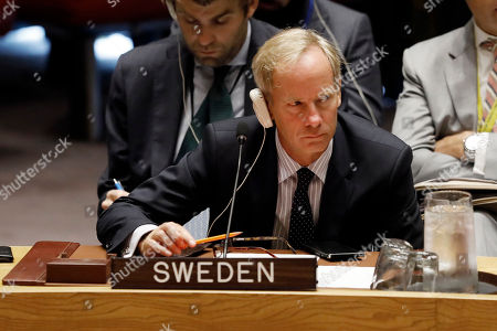 Sweden's United Nation's Ambassador Olof Skoog listens to remarks in the U.N. Security Council at U.N. headquarters