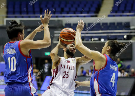 Khaled Mohamed Abdelbaset (C) of Qatar in action against Ian Sangalan (L) and Alexander Cabagnot (R) of the Philippines during the FIBA Basketball World Cup 2019 Group F qualifier match between the Philippines and Qatar at the Araneta Coliseum in Manila, Philippines, 17 September 2018. The match was played behind closed doors as a result of the brawl between the Philippines and Australia last July.