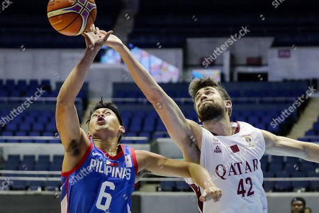 Earl Scottie Thompson (L) of the Philippines in action against Nasser Khalifa Al-Rayes (R) of Qatar during the FIBA Basketball World Cup 2019 Group F qualifier match between the Philippines and Qatar at the Araneta Coliseum in Manila, Philippines, 17 September 2018. The match was played behind closed doors without spectators as a result of the brawl between the Philippines and Australia last July.