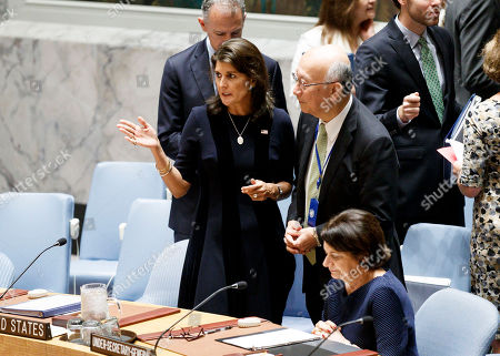 Nikki Haley (L), the United States' Ambassador to the United Nations, talks with Koro Bessho (R), Japan's Ambassador to the United Nations, during a United Nations Security Council meeting called by the United States in regards to allegations by the U.S. that certain countries are interfering with sanctions against North Korea in New York, New York, USA, 17 September 2018.