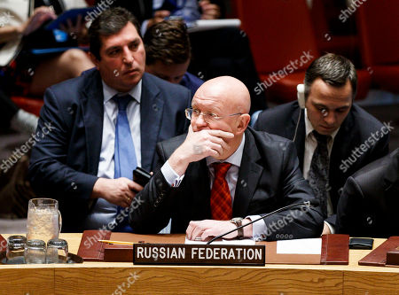 Vassily Nebenzia (C), Russian Ambassador to the United Nations, listens during a United Nations Security Council meeting called by the United States in regards to allegations by the U.S. that certain countries are interfering with sanctions against North Korea in New York, New York, USA, 17 September 2018.