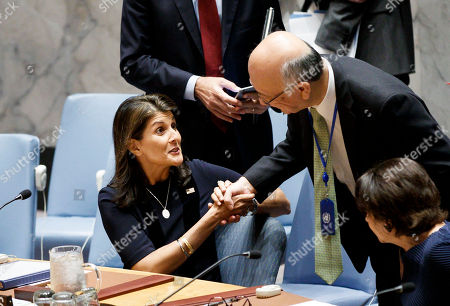Stock Picture of Nikki Haley (L), the United States' Ambassador to the United Nations, talks with Koro Bessho (R), Japan's Ambassador to the United Nations, during a United Nations Security Council meeting called by the United States in regards to allegations by the U.S. that certain countries are interfering with sanctions against North Korea in New York, New York, USA, 17 September 2018.
