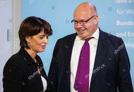 German Federal Minister for Economic Affairs and Energy Peter Altmaier (R) and Swiss Federal Councilor Doris Leuthard (L) speak after a press conference at the German Ministry of Economic Affairs in Berlin, Germany, 17 September 2018.