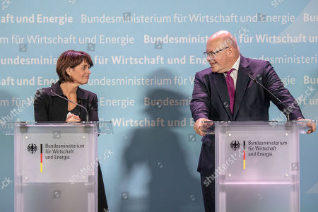 German Federal Minister for Economic Affairs and Energy Peter Altmaier (R) and Swiss Federal Councilor Doris Leuthard (L) attend a press conference at the German Ministry of Economic Affairs in Berlin, Germany, 17 September 2018.