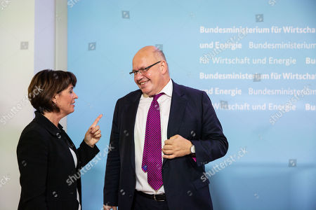 Federal Minister for Economic Affairs and Energy Peter Altmaier (R) and Swiss Federal Councilor Doris Leuthard (L) speak after a press conference at the German Ministry of Economic Affairs in Berlin, Germany, 17 September 2018.