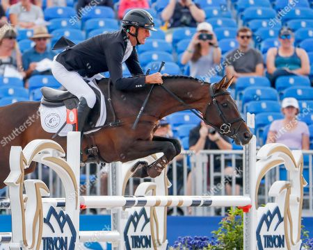 Sir Mark Todd of New Zealand competes on McClaren in the show jumping test of the Eventing competition during the FEI World Equestrian Games 2018 at the Tryon International Equestrian Center in Mill Spring, North Carolina, USA, 17 September 2018. The World Equestrian Games continue through to 23 September 2018.