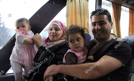 Displaced Syrians and their children are seen on board of buses upon their return from Lebanon to Damascus, Syria, on 17 September 2018. According to media reports, some 200 displaced Syrians arrived in Jdaidet Yabous and al-Dabbousyia crossings coming from Lebanon.  The reports said that the returnees will be transported to their villages and towns which were liberated by the Syrian army after cleaning their areas from militants.