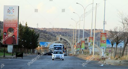 Buses carrying displaced Syrians upon their arrival from Lebanon to Damascus, Syria, 17 September 2018. According to media reports, some 200 displaced Syrians arrived in Jdaidet Yabous and al-Dabbousyia crossings coming from Lebanon.  The reports said that the returnees will be transported to their villages and towns which were liberated by the Syrian army after cleaning their areas from militants.