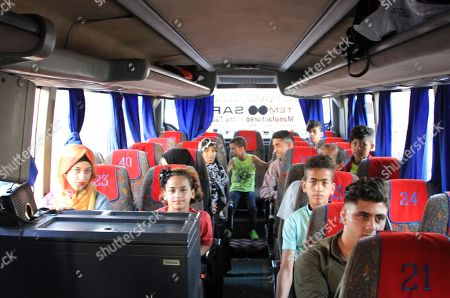 Displaced Syrians on board a bus upon their return from Lebanon to Damascus, Syria, 17 September 2018. According to media reports, some 200 displaced Syrians arrived in Jdaidet Yabous and al-Dabbousyia crossings coming from Lebanon.  The reports said that the returnees will be transported to their villages and towns which were liberated by the Syrian army after cleaning their areas from militants.