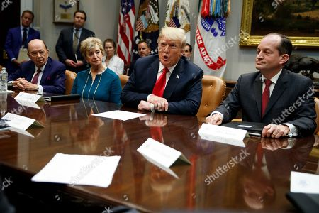 Donald Trump, WIlbur Ross, Linda McMahon, Alex Acosta. President Donald Trump speaks during a meeting of the President's National Council of the American Worker in the Roosevelt Room of the White House, in Washington, as from left, Secretary of Commerce Wilbur Ross, Small Business Administration administrator Linda McMahon and Secretary of Labor Alex Acosta listen