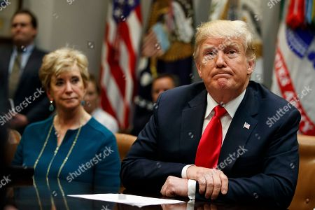 Donald Trump, Linda McMahon. Small Business Administration administrator Linda McMahon, left, and President Donald Trump listens to a reporters question during a meeting of the President's National Council of the American Worker in the Roosevelt Room of the White House, in Washington