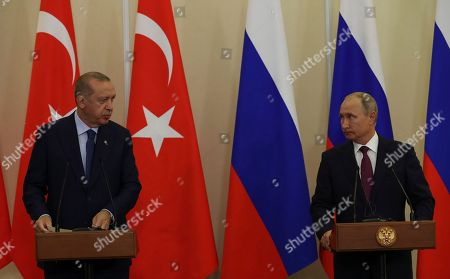 Russian President Vladimir Putin, right, listens to Turkey's President Recep Tayyip Erdogan, left, during a joint news conference following their meeting in Sochi, Russia, . The province of Idlib in northwestern Syria is the largest bastion of the opposition, and Turkey has been eager to prevent a potential government offensive there