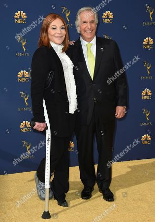 Stacey Weitzman, Henry Winkler. Stacey Weitzman, left, and Henry Winkler arrive at the 70th Primetime Emmy Awards, at the Microsoft Theater in Los Angeles