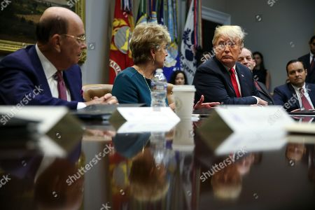 Administrator of the Small Business Administration, Linda McMahon (C), speaks as US President Donald J. Trump listens during the inaugural meeting of the President?s National Council for the American Worker in the Roosevelt Room of the White House, Washington, DC, USA,  17 September  2018.