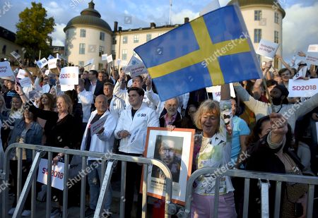 Supporters of Sweden Democrats party leader Jimmie Akesson during the campaign rally in Stockholm, Sweden, on September 8, 2018. Sweden's general election take place on September 9, 2018.