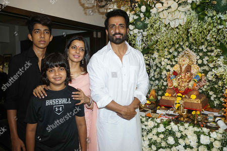 Bollywood actor Sonu Sood with his wife Sonali Sood celebrate Ganesha Chaturthi festival at his residence