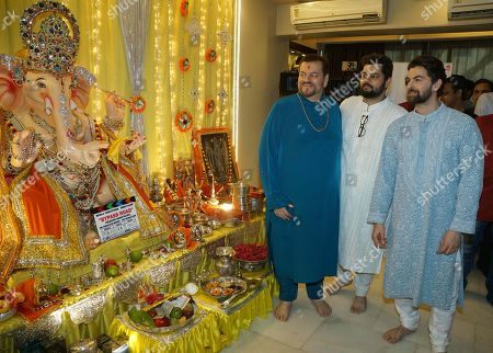 Bollywood actor Neil Nitin Mukesh with his father Nitin Mukesh and brother celebrate Ganesha Chaturthi festival at his residence