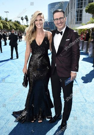 Kate Norley, John Oliver. Kate Norley, left, and John Oliver arrive at the 70th Primetime Emmy Awards, at the Microsoft Theater in Los Angeles