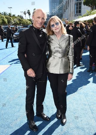 Ed Harris, Amy Madigan. Ed Harris, left, and Amy Madigan arrive at the 70th Primetime Emmy Awards, at the Microsoft Theater in Los Angeles